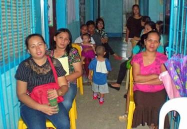School Parents seated in Corridor
